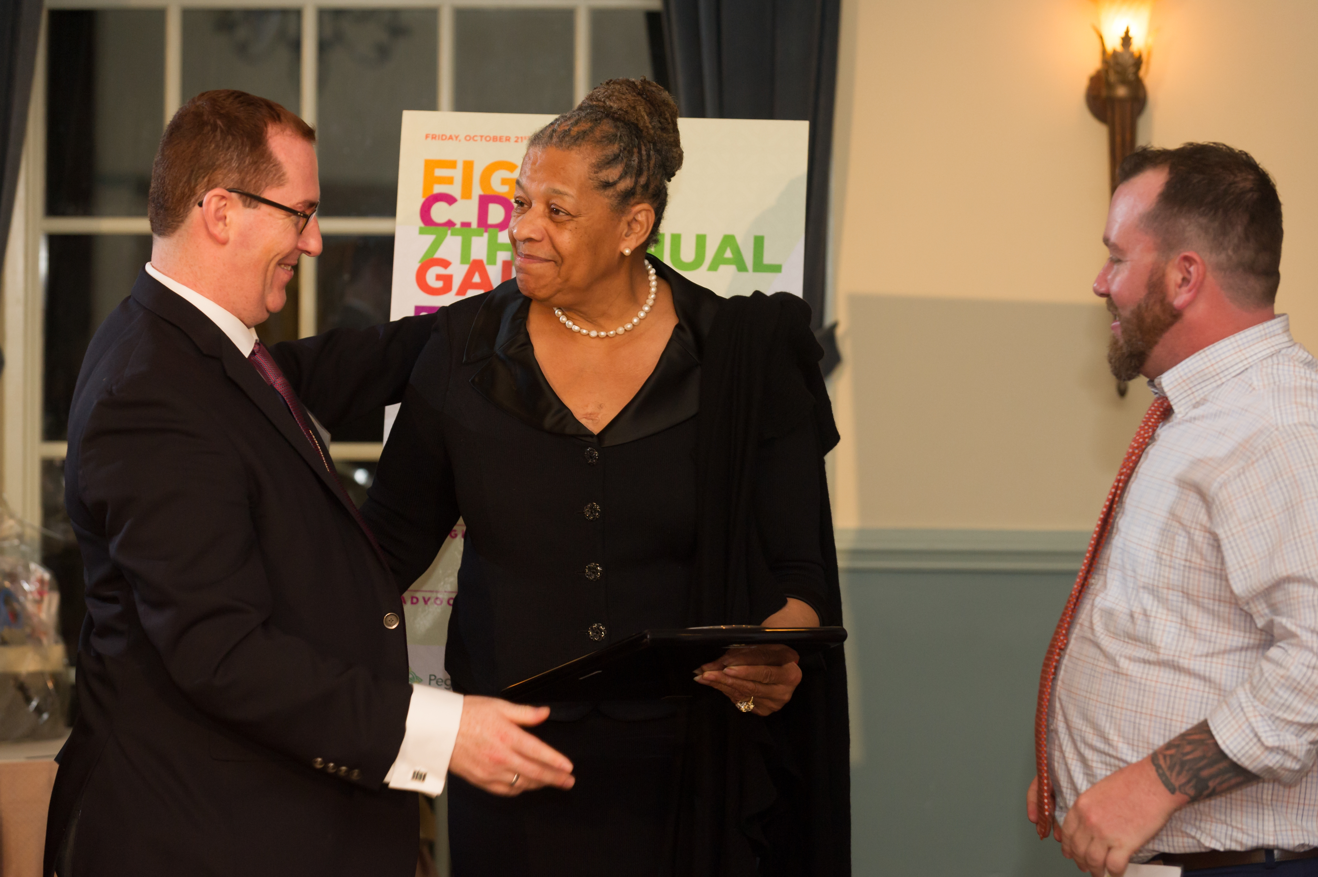 Former Senator Ruth Hassell-Thompson accepting the Advocates Award from Christian & Liam Lillis